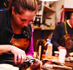 Shoemakers working in a workshop
