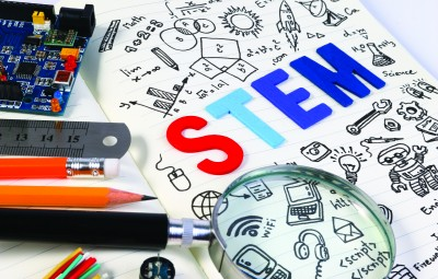 STEM education. Science Technology Engineering Mathematics. STEM concept with drawing background. Education background.STEM education. Science Technology Engineering Mathematics. STEM concept with drawing background. Magnifying glass over education background.