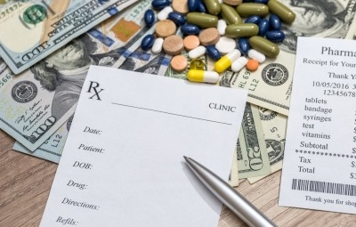 Cost of medicine - blank, money and pen