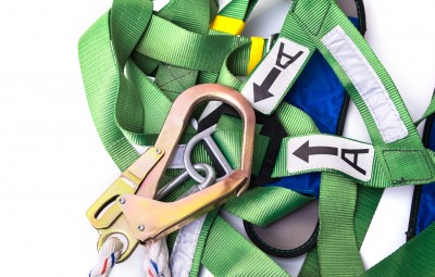 Closeup fall protection harness and lanyard for work at heights on white background.Closeup at safety hook.