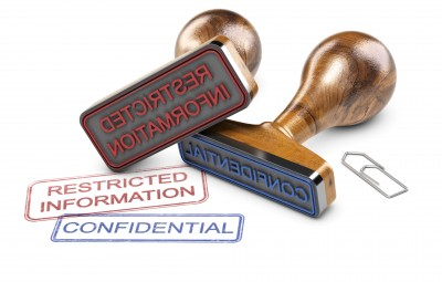Two rubber stamps over white background with the text restricted information and confidential. 3D illustration.